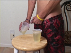 twink filling cup with piss peeing gay watersports gay fetish