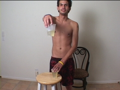 twink with two cups of his own piss fetish peeing